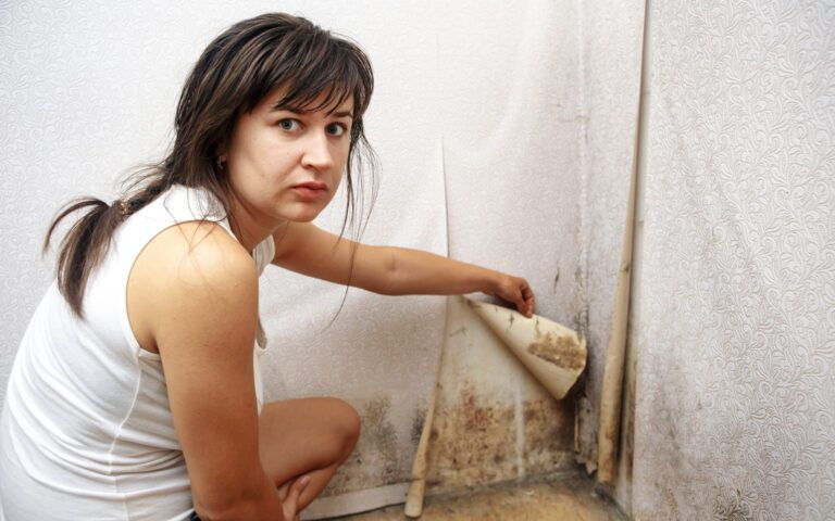 Woman finding black mold